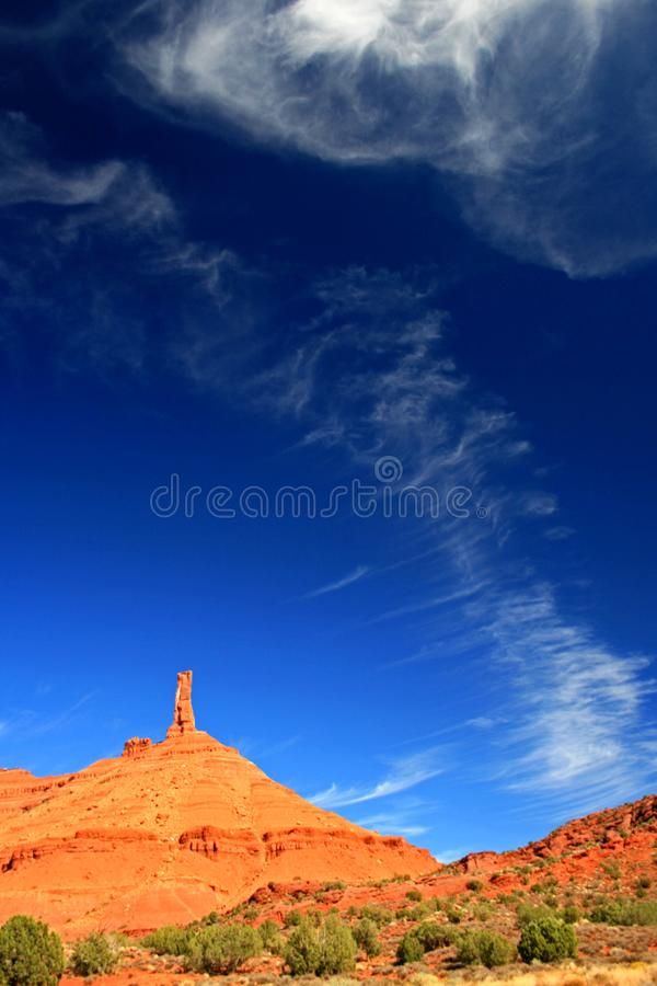 Castleton Tower with wispy clouds. Castleton Tower, Moab Area, Castle Valley, Grand County, Utah royalty free stock photography