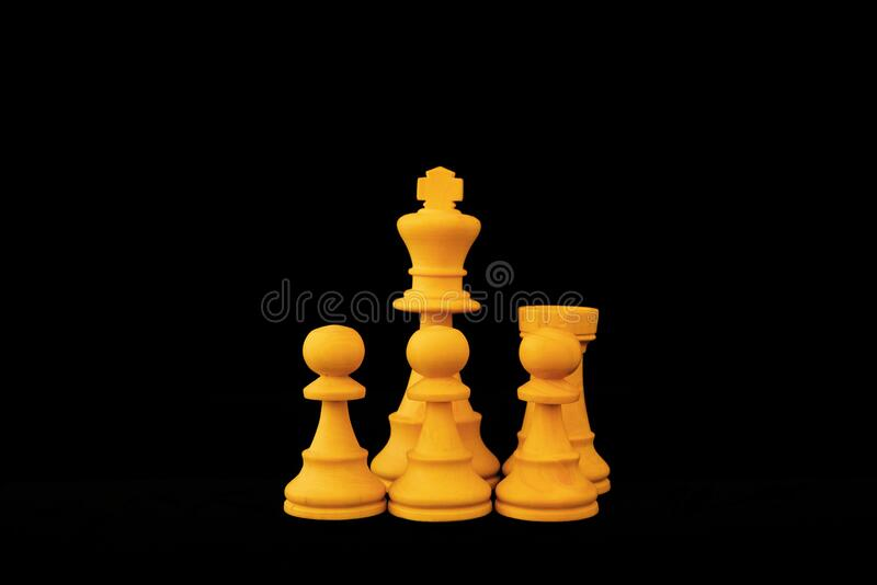 Castling move in Chess. Castling. A special move in the game of Chess to protect the King behind pawns and with rook. Standard chess wooden pieces on black royalty free stock photography