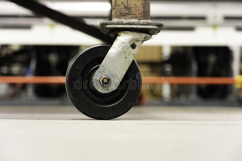 Castor - Caster wheels on factory workshop floor. On a trolley royalty free stock photos