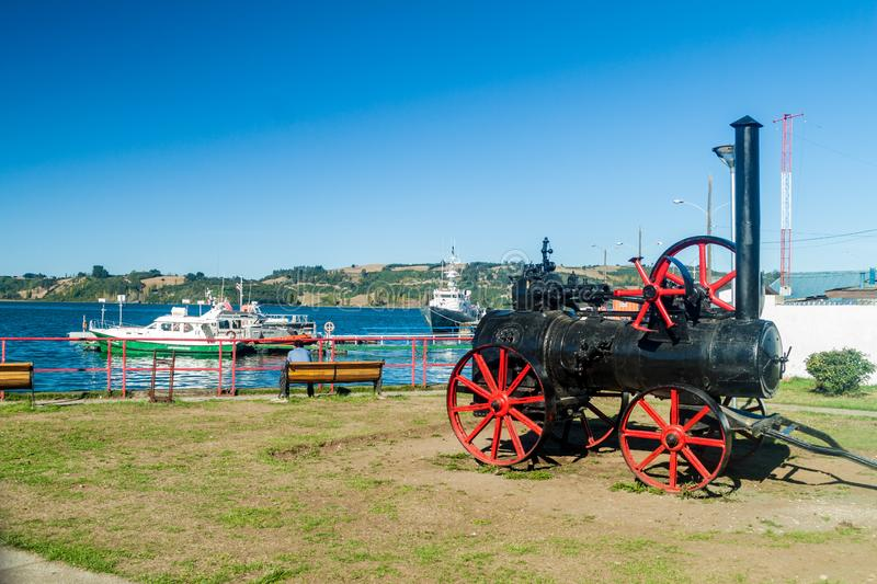 CASTRO, CHILE - MARCH 22, 2015: Old train engine displayed in Castro, Chiloe island, Chi. CASTRO, CHILE - MARCH 22, 2015: Old train engine displayed in Castro stock images