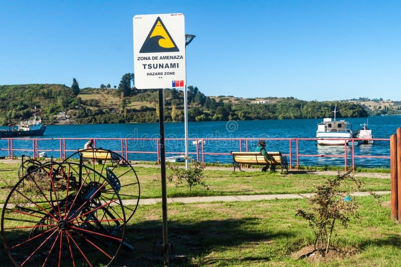 CASTRO, CHILE - MARCH 22, 2015: Tsunami hazard warning sign in Castro, Chiloe island, Chi royalty free stock photography
