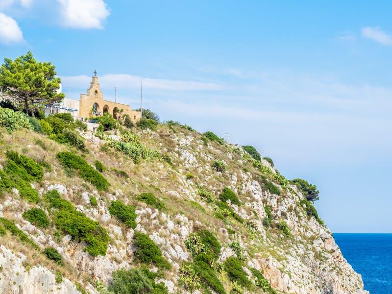 Castro townscape in Apulia coast Salento, overlooking the Adriatic Sea, Italy. Castro townscape in Apulia coast, Italy, a village perched on a cliff, overlooking stock image
