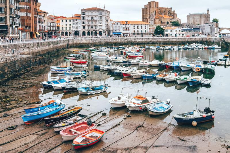 LOW TIDE hour in Castro Urdiales - seaport of northern Spain, i. Castro Urdiales , Spain - July 28, 2017: LOW TIDE hour in Castro Urdiales - seaport of northern royalty free stock photos