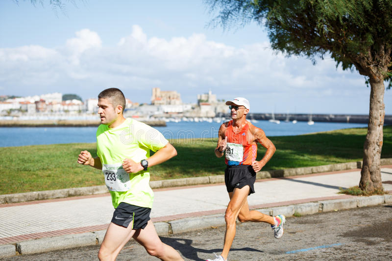 CASTRO URDIALES, SPAIN - SEPTEMBER 18: Unidentified group of athletes in the in the 10km race competition celebrated in Castro Urd. Iales in September 18, 2016 royalty free stock photo