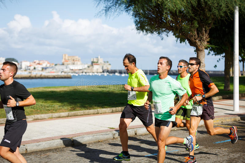 CASTRO URDIALES, SPAIN - SEPTEMBER 18: Unidentified group of athletes in the in the 10km race competition celebrated in Castro Urd. Iales in September 18, 2016 stock photos