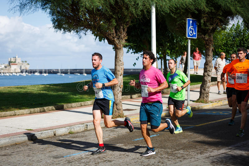 CASTRO URDIALES, SPAIN - SEPTEMBER 18: Unidentified group of athletes in the in the 10km race competition celebrated in Castro Urd. Iales in September 18, 2016 stock photo