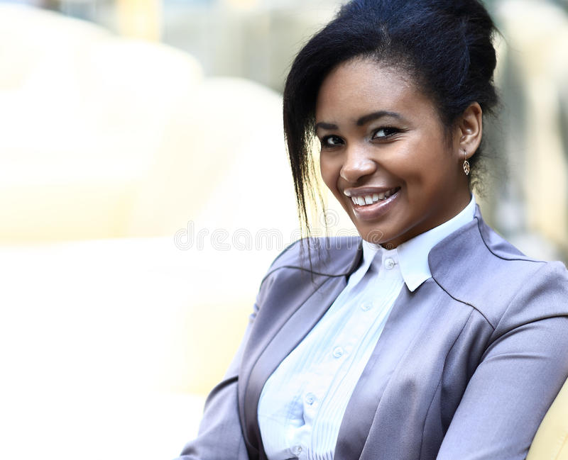 Casual african business woman. Looking happy and smiling stock photo