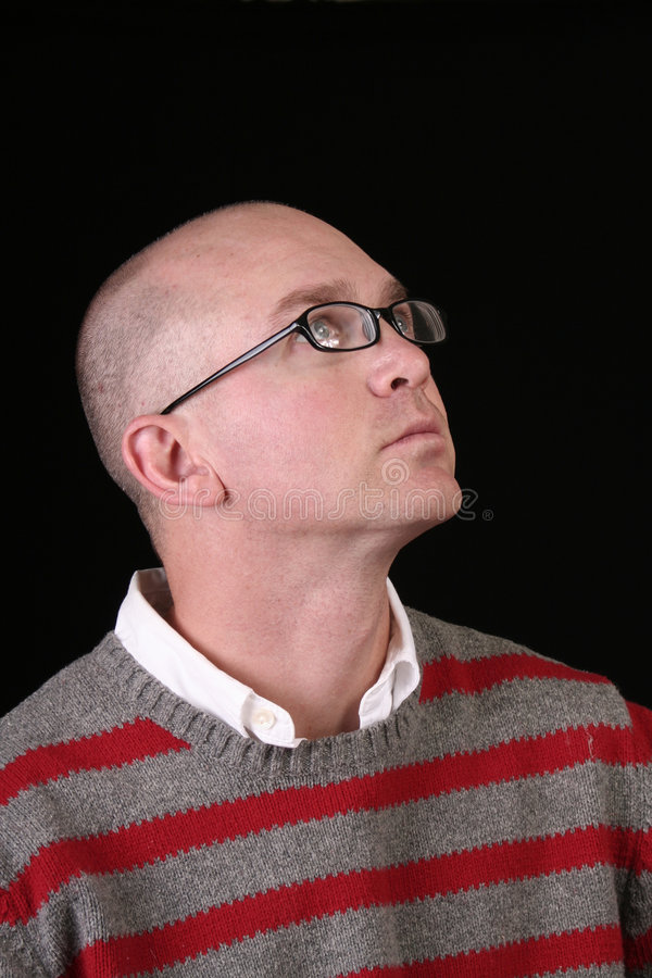 Casual bald man looking up stock photography