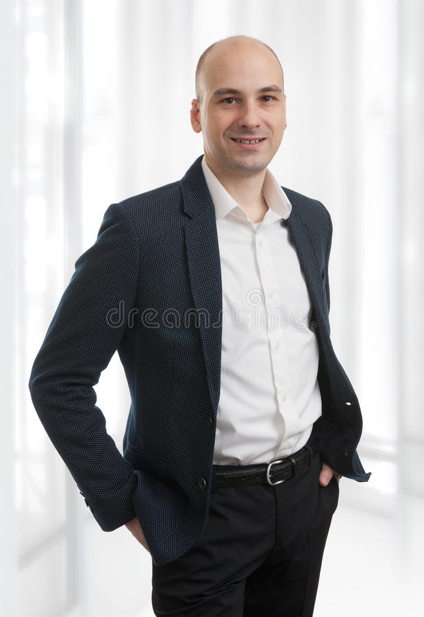 Casual bald man wearing suit stock photography