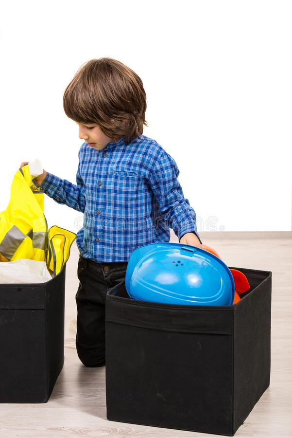 Casual boy with boxes with tools. Casual boy arrange tools in boxes and sitting on floor royalty free stock image