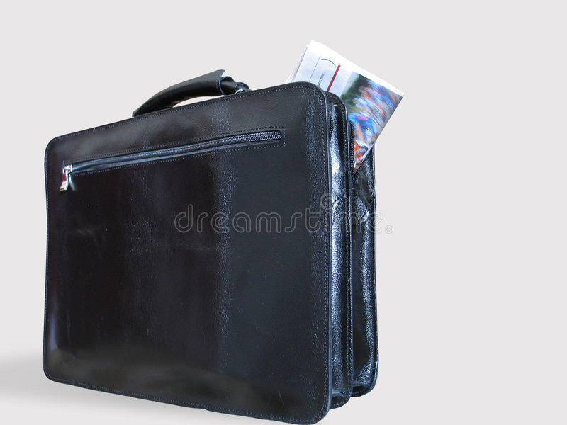 A Casual Briefcase and a Newspaper Inside It royalty free stock images