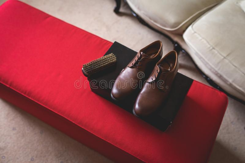 Casual brown leather male shoes on the box stock photo