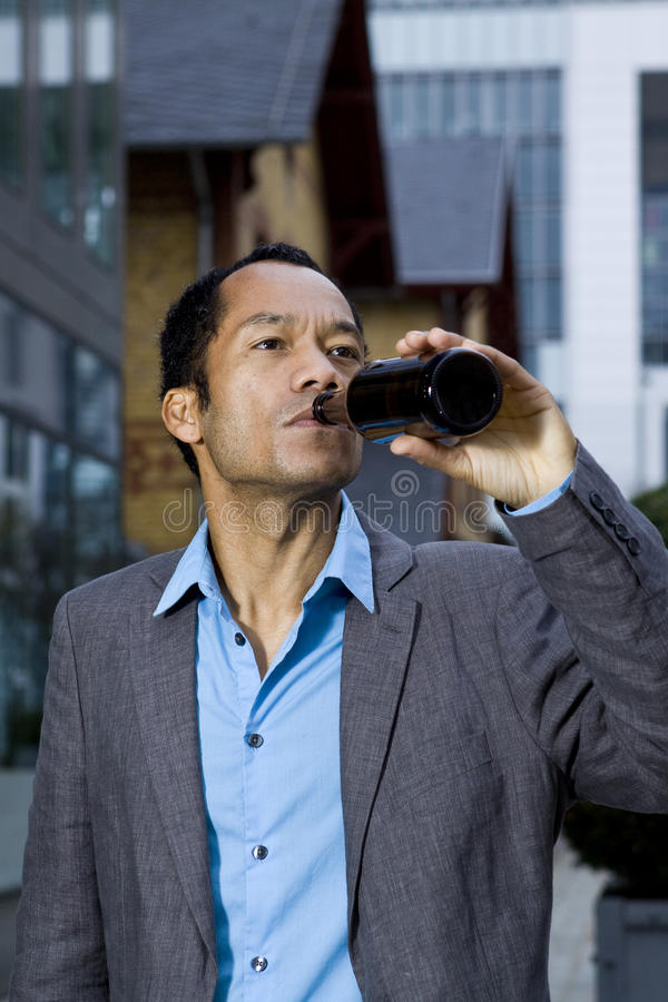 Casual business man drinking after work stock image