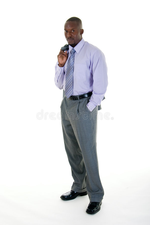 Casual Business Man in Gray Suit. Handsome African American man in a gray business suit with the coat tossed over his shoulder for a more casual look royalty free stock images