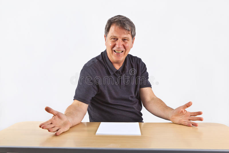 Casual business man sitting at a table stock images