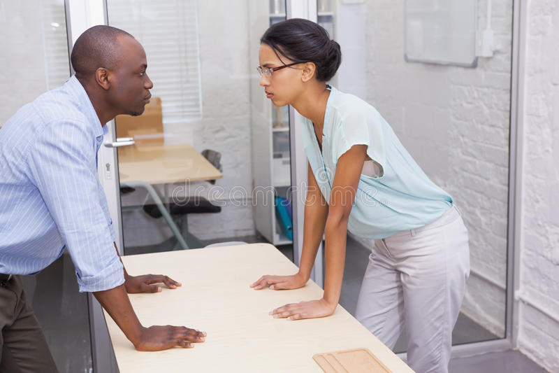 Casual business partners having an argument royalty free stock image