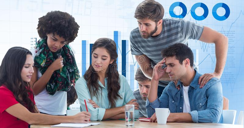 Casual business people discussing against graphs stock images