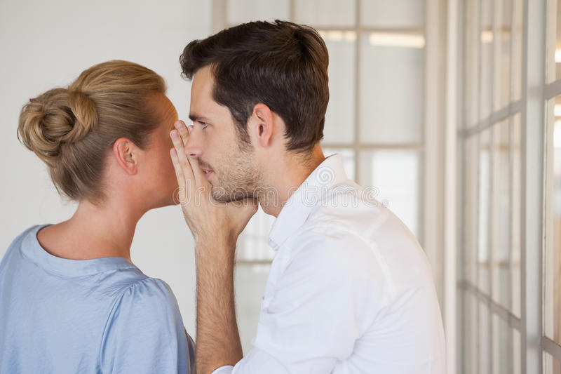 Casual business people gossiping together stock image
