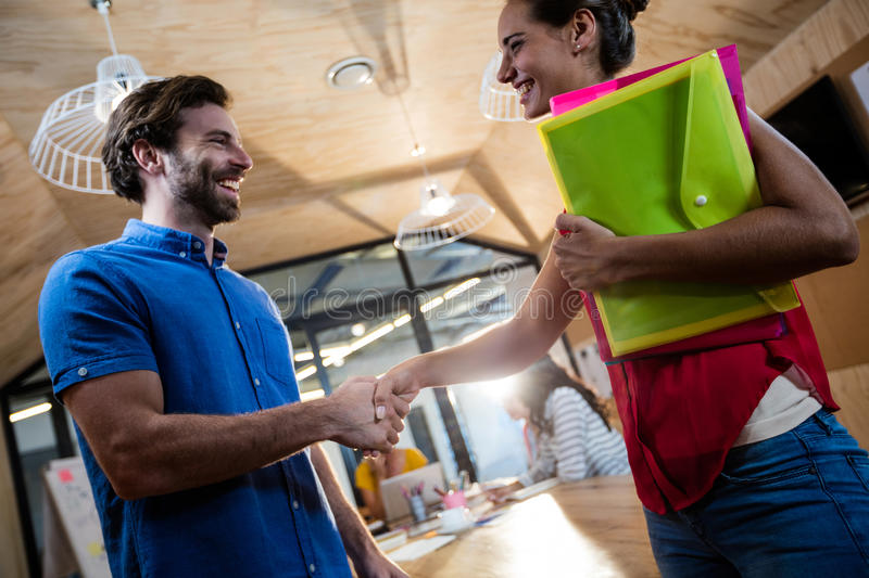Casual business people shaking their hands royalty free stock images