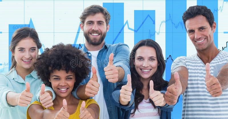 Casual business people showing thumbs up gestures against graphs stock photography