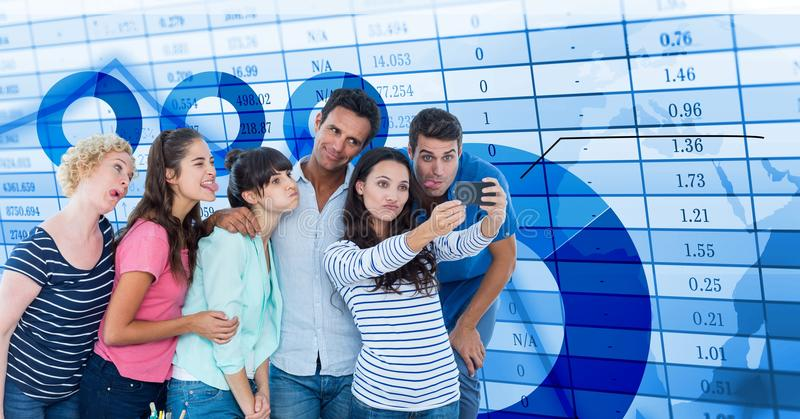Casual business people taking selfie on smart phone by data royalty free stock photos