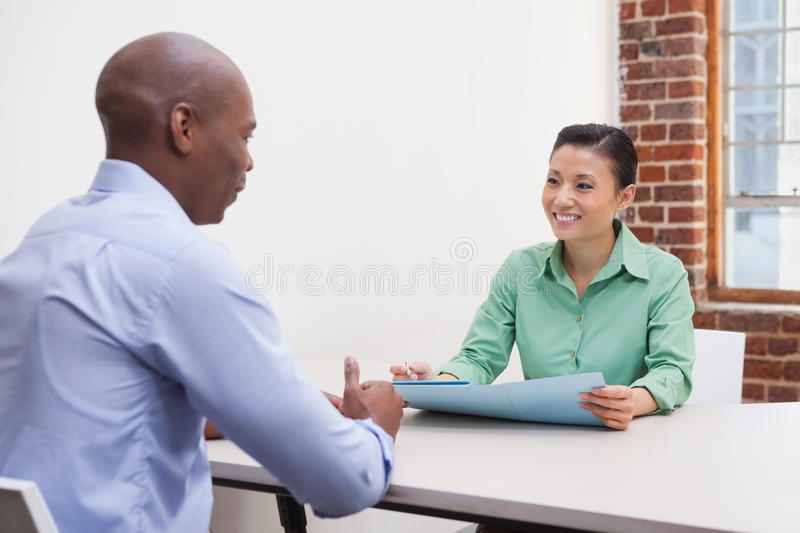 Casual business people talking at desk stock photos
