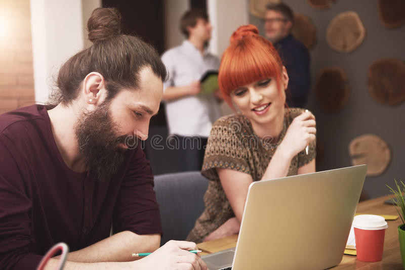Casual business. Stylish people Working at the office royalty free stock images