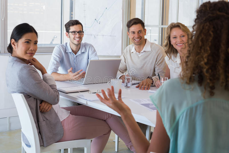 Casual business team having a meeting stock photography