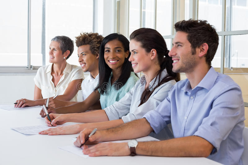 Casual business team having a meeting stock image