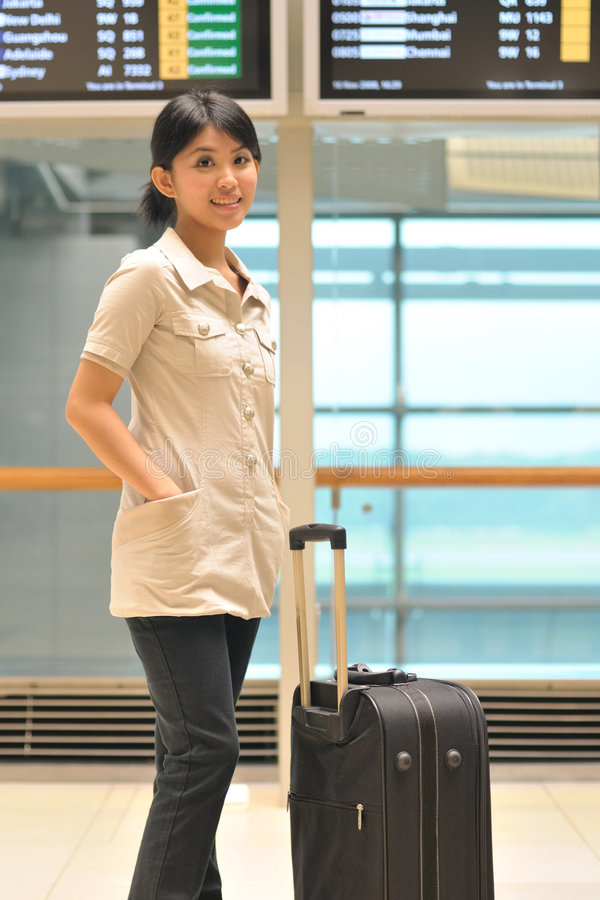 Casual business woman at airport royalty free stock photo