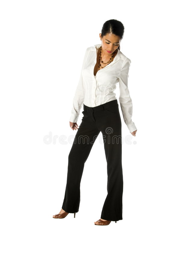 Casual Business Woman On White. Casual Asian American business woman in black slacks and white blouse isolated over white Full body royalty free stock photography