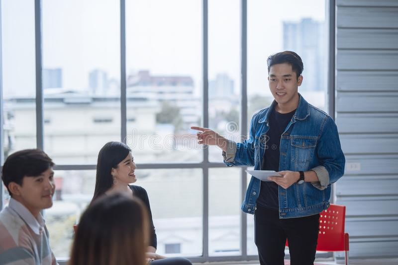 Casual businessman having business meeting with his staff. showing presentation. Casual businessman having business meeting with his staff. showing presentation stock photography