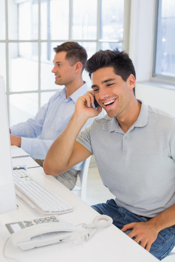 Free Casual Businessman Laughing On The Phone At His Desk Royalty Free Stock Photography - 39432837