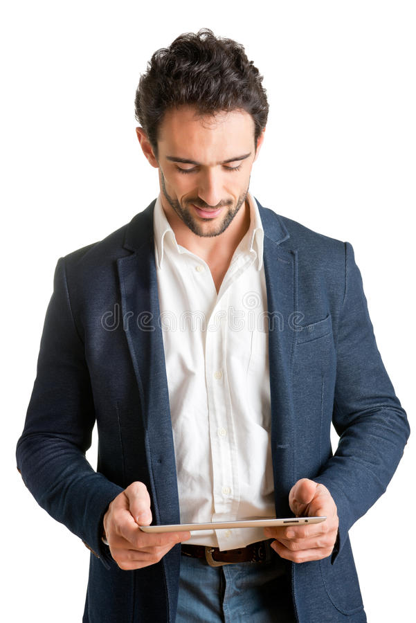 Casual Businessman Looking at a Tablet royalty free stock image