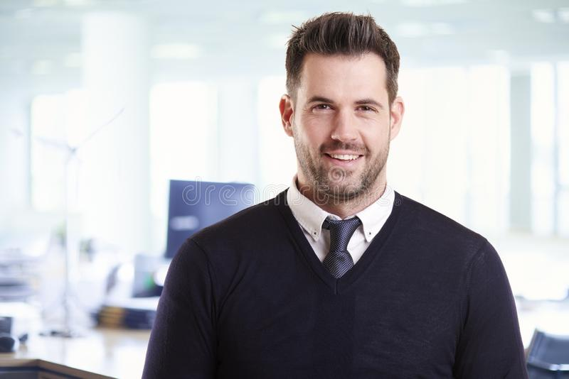 Casual businessman portrait while standing in the office stock photography
