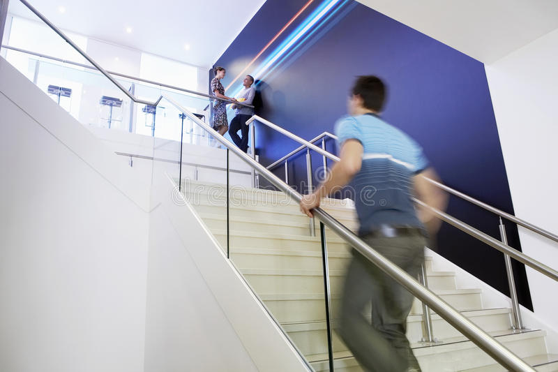 Casual Businessman Walking Up Stairs royalty free stock photos