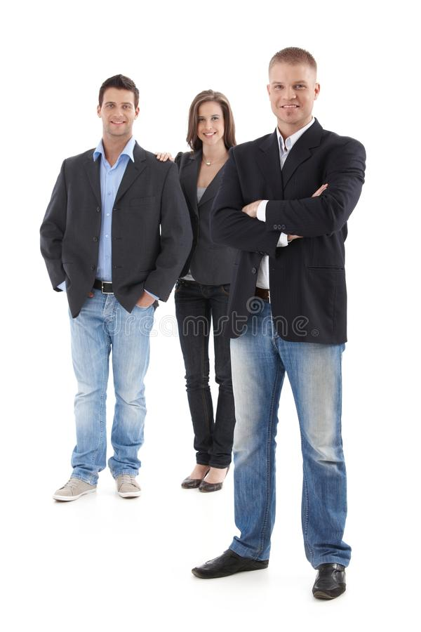 Casual businesspeople posing in studio stock photo