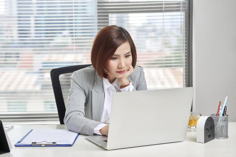 Casual businesswoman thinking about possibility of seeking new business opportunities.  stock images