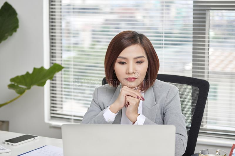 Casual businesswoman thinking about possibility of seeking new business opportunities.  royalty free stock images