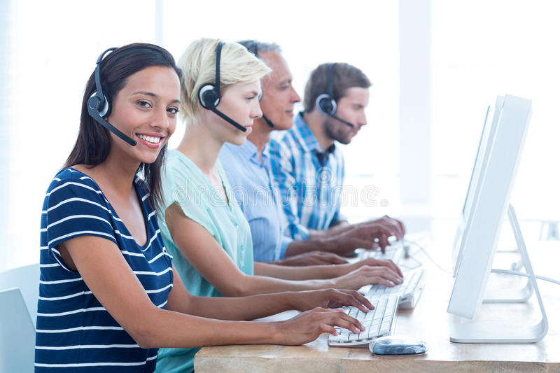 Casual call centre workers in the office. Portrait of young casual call centre workers in the office stock image