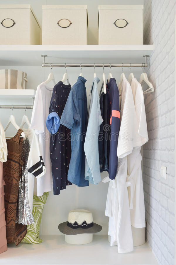 Casual cloths hanging in open wardrobe stock image
