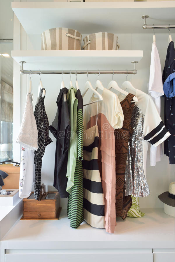 Casual cloths hanging in wardrobe royalty free stock photos