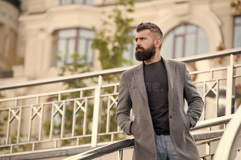 Casual and comfortable outfit for autumn date. Man bearded hipster stylish appearance waiting someone. Confident hipster royalty free stock images