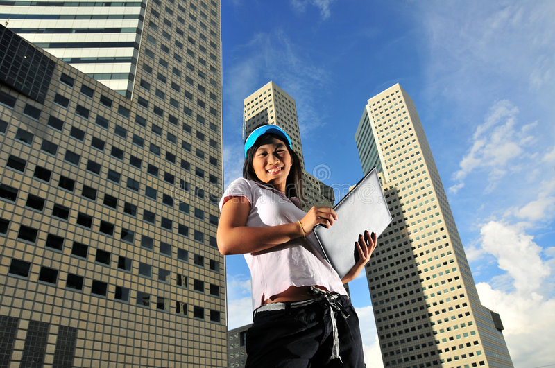 Casual Corporate 3. Picture of girl in casual attire. Can signify an intern, a dressed down friday or picture of a friendly face in the serious corporate world stock photography