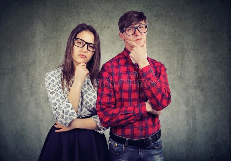 Skeptical young man and woman royalty free stock photography