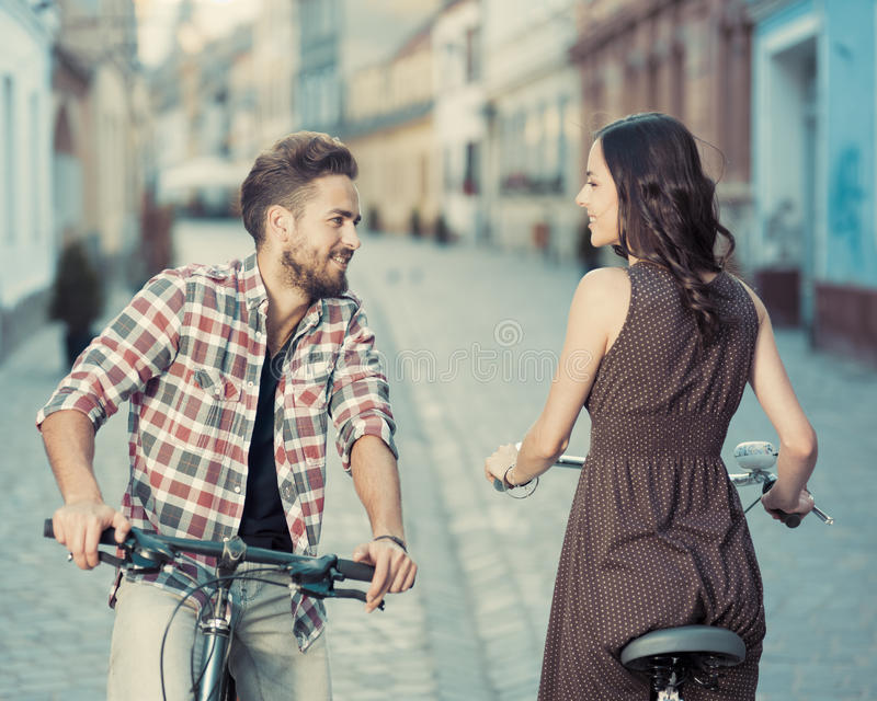Casual cyclists stop to smile royalty free stock images