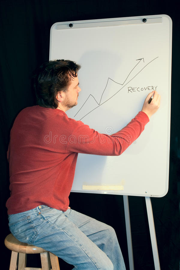 Casual Executive Gives Presentation On Whiteboard Stock Images