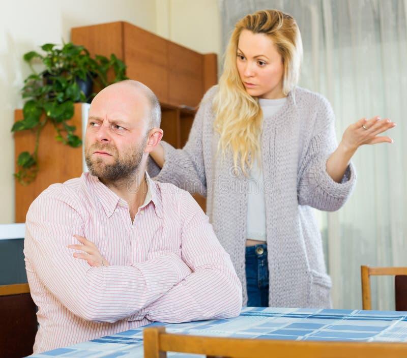 Casual family having quarrel. Casual adult family having quarrel at home royalty free stock images
