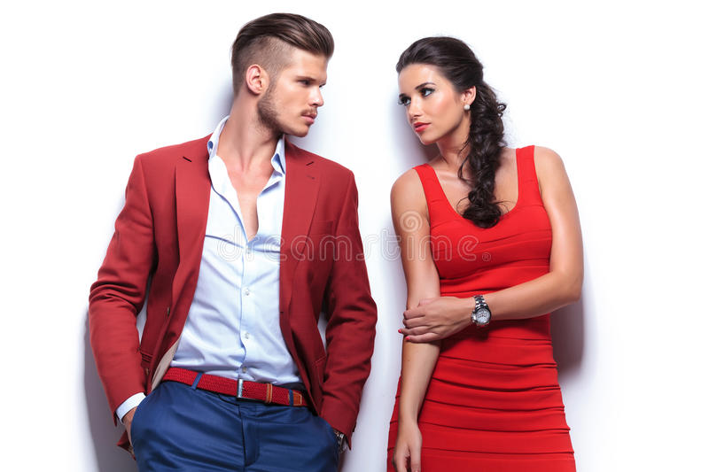 Casual fashion man and woman looking at each other stock photos