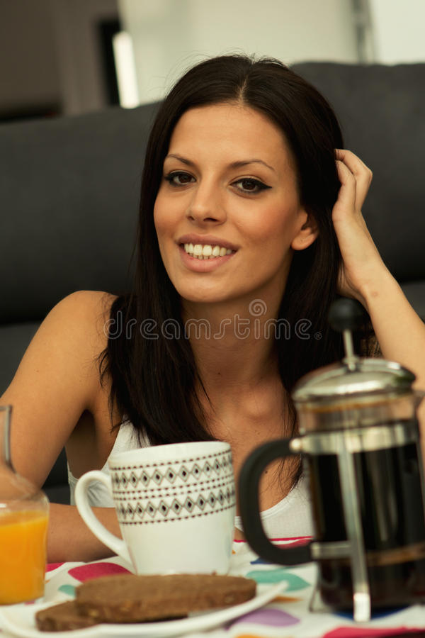 Casual girl at home take the breakfast. On weekend royalty free stock image